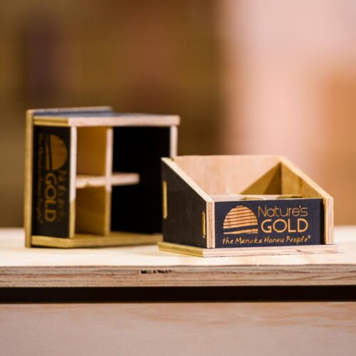 Nature's Gold Manuka Honey plywood display with black finish and lasered logo