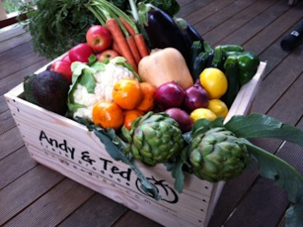 Little wood crate with fruit and veg ready for home delivery